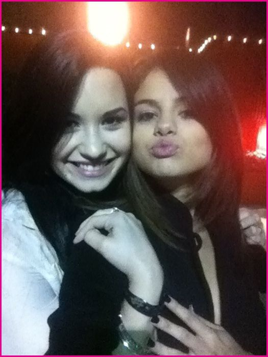 selena gomez and demi lovato kissing each other. selena gomez and demi lovato